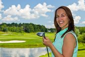 pic of ladies golf  - Woman at the golf course on a beautiful summer day - JPG