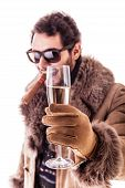 stock photo of hustler  - a young man wearing a sheepskin coat isolated over a white background holding a cigar and a glass with champagne