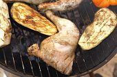 picture of thigh highs  - fresh group of grilled chicken thighs with green orange yellow pepper bell slice and eggplants on hot grill bbq high resolution - JPG