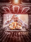 foto of she-male  - Funny chef overlooked roast chicken in the oven - JPG