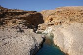 foto of oman  - Rocky water canyon in sultanate of Oman - JPG