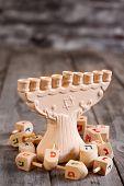 stock photo of menorah  - Jewish Holiday Hannukah Symbols - Menorah And Wooden Dreidels. Copy Space Background. ** Note: Shallow depth of field - JPG