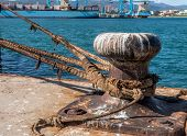 image of bollard  - bollard with thick ropes in a harbour - JPG