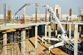 foto of boom-truck  - construction building works with automobile concrete pump  - JPG