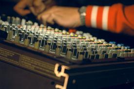 stock photo of recording studio  - Musician hands over audio panel - JPG