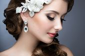 picture of studio  - Portrait of a beautiful woman in a wedding dress in the image of the bride - JPG