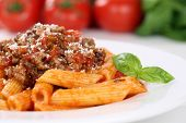 pic of noodles  - Penne Rigate Bolognese or Bolognaise sauce noodles pasta meal on a plate - JPG