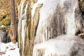 Постер, плакат: Icicles And Ice On The Rocks