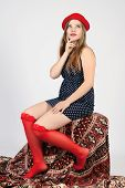 image of garter  - young girl in a red hat and garters sitting - JPG