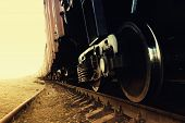 stock photo of train-wheel  - Train on the tracks with a large iron wheels on concrete sleepers perspective goes beyond the horizon line in the sunlight. Latvia Europe