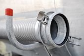 pic of cistern  - Industrial metal hose from a cistern reservoir - JPG
