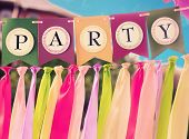 stock photo of swag  - Colourful festive swag banner with ribbons for party decoration - JPG