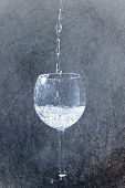foto of squirt  - Squirt in glass in drops of water in grunge retro style - JPG