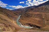 stock photo of jammu kashmir  - Beautiful Zanskar river flowing through rocks of Ladakh Jammu and Kashmir Ladakh India natural landscape scenic waterbody riverbank aerial view brown rocks downstream - JPG