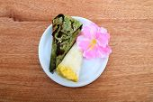 stock photo of soy bean  - thai dessert from soy bean and rice grill in wrap banana leaf - JPG