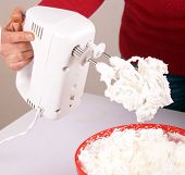 image of cake-mixer  - Studio shot of a woman with an electric mixer - JPG