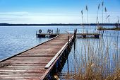pic of pier a lake  - Pier for pleasure and fishing boats on shore of Lake Ladoga in Karelia - JPG