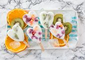 stock photo of popsicle  - Homemade frozen popsicles with yogurt and fresh fruits - JPG