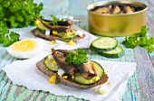 foto of sandwich  - Sandwich with small smoked fish cucumber and eggs - JPG