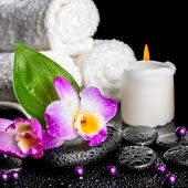 image of calla  - spa background of orchid dendrobium green leaf Calla lily candle towels and beads on zen stones with drops closeup - JPG