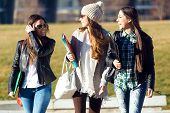 foto of three life  - Portrait of three students girls walking in the campus of university - JPG