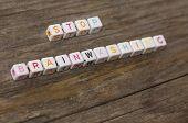 stock photo of brainwashing  - Stop brainwashing text on a wooden background - JPG