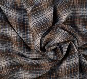 picture of fragmentation  - Wrinkled squared brown cloth fabric fragment as an abstract background composition - JPG