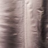 foto of down jacket  - Creased down jacket fragment as a background texture composition - JPG