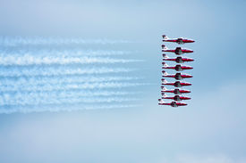 picture of snowbird  - Snowbirds full formation flying synchronously while leaving trails of smoke behind - JPG