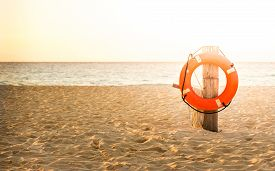 image of water-saving  - Life preserver on sandy beach somewhere in Mexico - JPG