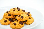 picture of baked raisin cookies  - Raisin and cornflake cookies on white background - JPG