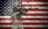 picture of rifle  - soldier holding rifle on a usa flag background double exposure - JPG