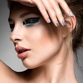 stock photo of nail-design  - Beautiful girl with bright creative fashion makeup and Grey nail polish - JPG