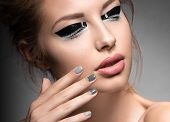 pic of nail-design  - Beautiful girl with bright creative fashion makeup and Grey nail polish - JPG