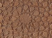 picture of wooden door  - Islamic flowers and stars motif pattern carved on the surface of an old wooden door - JPG