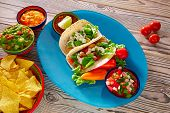 stock photo of nachos  - Fish tacos mexican food with guacamole nachos and chili pepper sauce - JPG