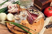 picture of vodka  - Vodka and smoked meat on wooden table - JPG