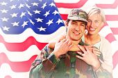 stock photo of reunited  - Army wife reunited with husband against rippled us flag - JPG