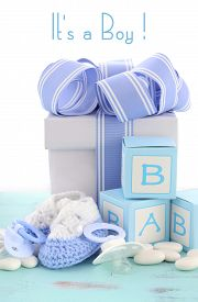 foto of teething baby  - Baby shower Its a Boy blue gift with gift box baby booties and dummy on pale blue shabby chic rustic wood table - JPG