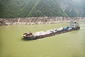 foto of coal barge  - Coal barge sailing along the Three gorges region of Yangtze river in China - JPG
