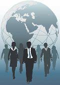 stock photo of eastern hemisphere  - Global business team emerging from globe as symbol of human resources workforce - JPG