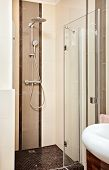 Shower cubicle in beige tones