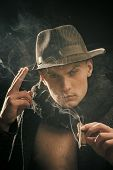 Vintage Detective Concept. Man In Coat, Hat Smoking Cigar, Dark Background. Guy In Old Fashioned Out poster