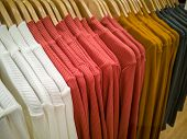 Multi-colored T-shirt Hanging In The Lining Of The Shopping Mall. poster