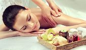 Massage And Body  Care. Spa Body Massage   Woman Hands Treatment. Woman Having Massage In The Spa Sa poster