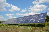 Solar Panels With Beautiful Clouds Sky. Solar Panels For Green Energy. poster