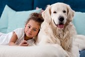 Adorable African American Child With Happy Dog Smiling At Camera poster