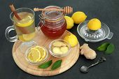 Natural flu and cold remedy ingredients with fresh ginger, lemon fruit, cinnamon sticks and honey wi poster