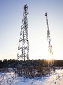 Telecommunication Towers At Sunset. Ladders, Support Towers And Metal Structures Cell Towers. Vertic poster