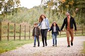 Family On Autumn Walk In Countryside Together poster